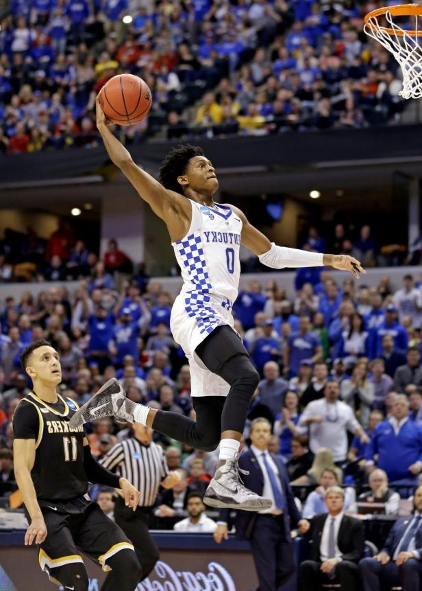 slide-3-of-63-kentucky-guard-deaaron-fox-0-goes-up-for-a-dunk-in-front-of-wichita-state-guard-landry_119491_